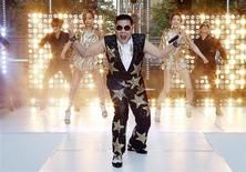 "South Korean singer Psy performs his hit ""Gangnam Style"" during a morning television appearance in central Sydney October 17, 2012. REUTERS/Tim Wimborne"