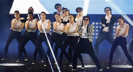 South Korean rapper Psy performs ''Gentleman'' during his concert ''Happening'' in Seoul April 13, 2013. REUTERS/Lee Jae-Won