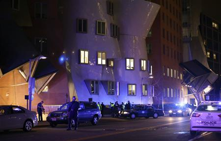 Police officers secure a school building at the Massachusetts Institute of Technology (MIT) near where a police officer was reportedly shot in Cambridge, Massachusetts April 18, 2013. REUTERS/Kristyn Ulanday