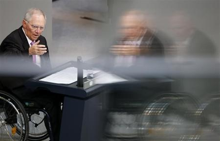 German Finance Minister Wolfgang Schaeuble is reflected in a window as he addresses the lower house of parliament Bundestag in Berlin, April 18, 2013. REUTERS/Fabrizio Bensch