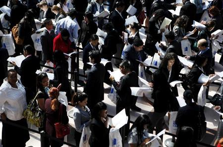 People wait in line to enter the City University of New York (CUNY) Big Apple job fair in New York, April 23, 2010. REUTERS/Shannon Stapleton