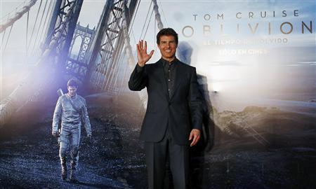 U.S. actor Tom Cruise poses as he arrives for the world premiere of his movie ''Oblivion'' in Buenos Aires in this March 26, 2013 file photo. REUTERS/Marcos Brindicci/Files