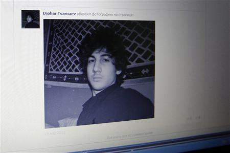 A photograph of Djohar Tsarnaev, who is believed to be Dzhokhar Tsarnaev, a suspect in the Boston Marathon bombing, is seen on his page of Russian social networking site Vkontakte (VK), as pictured on a monitor in St. Petersburg April 19, 2013. REUTERS/Alexander Demianchuk