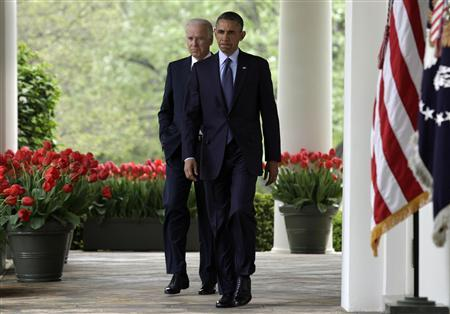 U.S. President Barack Obama (R) arrives with Vice President Joe Biden to deliver a statement on commonsense measures to reduce gun violence, in the Rose Garden of the White House in Washington April 17, 2013. REUTERS/Yuri Gripas