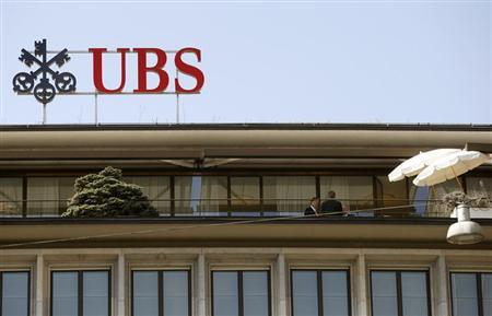 People stand on a terrace of an office building of Swiss bank UBS at the Paradeplatz square in Zurich April 18, 2013. REUTERS/Arnd Wiegmann