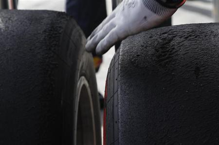 A pair of Pirelli's new P Zero Red supersoft tyres are seen after the second practice session of the Australian F1 Grand Prix at the Albert Park circuit in Melbourne March 15, 2013. REUTERS/Brandon Malone
