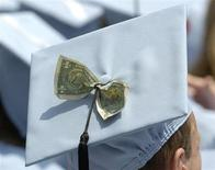 Graduates celebrate receiving a Masters in Business Administration from Columbia University during the year's commencement ceremony in New York in this May 18, 2005 file photo. REUTERS/Chip East/Files