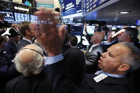 Traders react as SeaWorld Entertainment begins trading following the company's IPO at the New York Stock Exchange, April 19, 2013. REUTERS/Brendan McDermid