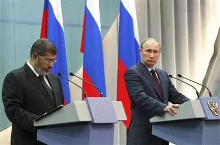 Russian President Vladimir Putin (R) and his Egyptian counterpart Mohamed Mursi attend a news conference after talks in Sochi, April 19, 2013. REUTERS/Mikhail Klimentyev/RIA Novosti/Pool