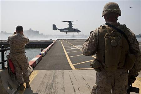 The V-22 Osprey arrives for the Marines from the 1st Battalion 9th Marines Charlie Company 2nd Platoon during a tactical demonstration as a part of Fleet Week in New York, May 26, 2012. REUTERS/Andrew Burton