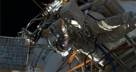 A member of the Expedition 35 crew is shown in this still image from NASA television venturing outside the International Space Station for a six-hour spacewalk to deploy and retrieve several science experiments and install a new navigational aid April 19, 2013. REUTERS/NASA TV/Handout