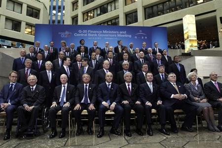 IMF Managing Director Christine Lagarde (2nd R) joins finance ministers and central bank governors from the G20 as they pose for a family photo during the 2013 Spring Meeting of the International Monetary Fund and World Bank in Washington, April 19, 2013. REUTERS/Yuri Gripas