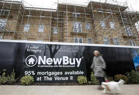 A woman walks past a new residential property development in London, March 21, 2013. REUTERS/Neil Hall