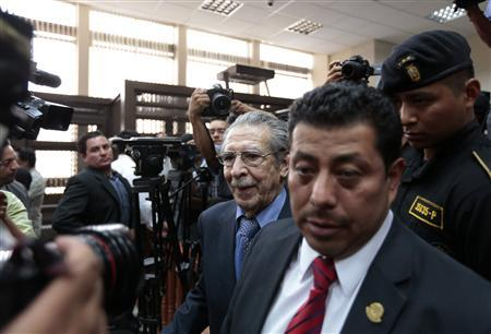 Guatemala's ex-dictator Efrain Rios Montt (C) exits after a hearing at the Supreme Court of Justice in Guatemala City April 18, 2013. REUTERS/Jorge Dan Lopez