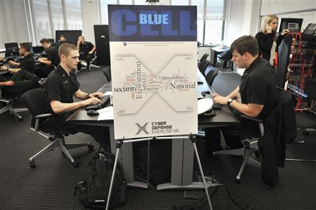 Competitors participate in the 13th National Security Agency cyber competition in this handout photo provided by the U.S. Navy at the U.S. Naval Academy in Annapolis, Maryland April 17, 2013. REUTERS/U.S. Navy Academy/Handout