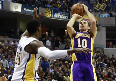 Los Angeles Lakers guard Steve Nash (10) of Canada shoots the basketball over Indiana Pacers center Ian Mahinmi of France during the first half of an NBA basketball game in Indianapolis, Indiana March 15, 2013. REUTERS/Brent Smith