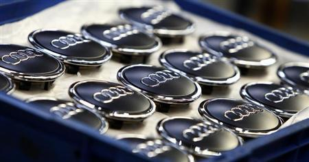 Hub caps for Audi A3 are pictured next to the production line of the German car manufacturer's plant in the Bavarian city of Ingolstadt March 11, 2013. REUTERS/Michaela Rehle