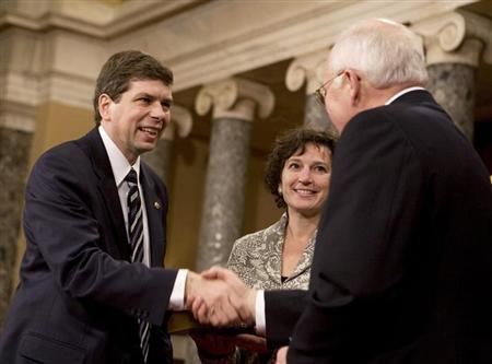 U.S. Sen. Mark Begich (L) (D-AK), accompanied by his wife Deborah Bonito, shakes hands with U.S. Vice President Dick Cheney at the Old Senate Chamber on Capitol Hill in Washington January 6, 2009. REUTERS/Larry Downing