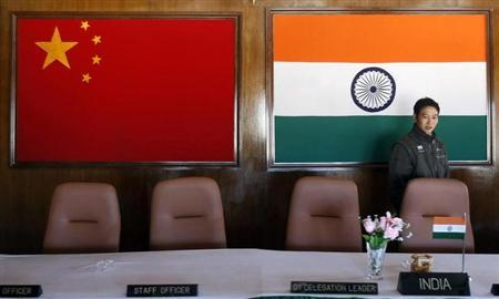A man walks inside a conference room used for meetings between military commanders of China and India, at the Indian side of the Indo-China border at Bumla, in Arunachal Pradesh, November 11, 2009. REUTERS/Adnan Abidi/Files