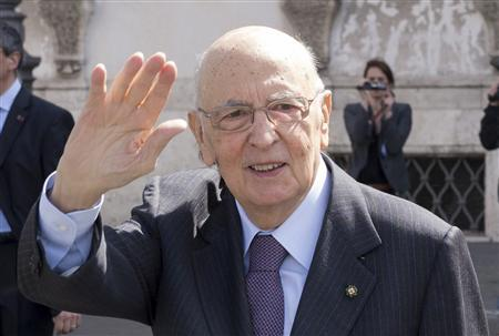 Italian President Giorgio Napolitano waves at the end of a meeting with the ''wise men'' at the Quirinale palace in Rome in this picture provided by the Italian Presidency Press Office April 12, 2013. REUTERS/Italian Presidency Press Office/Handout