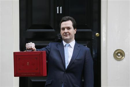 Britain's Chancellor of the Exchequer, George Osborne, holds up his budget case for the cameras as he stands outside number 11 Downing Street, before delivering his budget to the House of Commons, in central London in this March 20, 2013 file photo. REUTERS/Stefan Wermuth/Files
