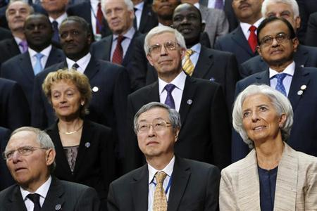 (L-R) Germany's Finance Minister Wolfgang Schaeuble, Swiss Finance Minister Eveline Widmer-Schlumpf, China's Central Bank Governor Zhou Xiaochuan, Russia's Central Bank Governor Sergei Ignatyev, IMF Managing Director Christine Lagarde, and India's Finance Minister P. Chidambaram take their places for an International Monetary Fund governors group photo during IMF and World Bank spring meetings in Washington, April 20, 2013. REUTERS/Jonathan Ernst