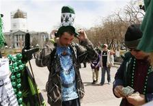 A participant at the 4/20 marijuana holiday buys a hat depicting marijuana plants in Civic Center Park in downtown Denver April 20, 2013. REUTERS/Rick Wilking