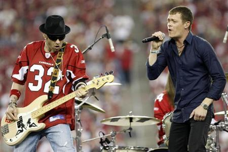 Brad Arnold (R) and Todd Harrell of the rock band ''3 Doors Down'' perform at halftime during NFL Wild-Card Round playoff football game with the Arizona Cardinals and the Atlanta Falcons in Glendale, Arizona January 3, 2009. REUTERS/Rick Scuteri