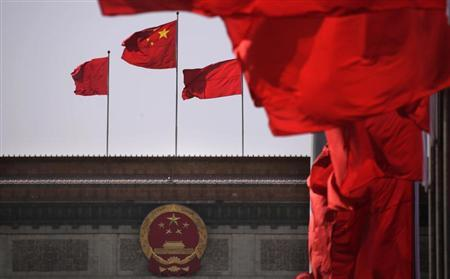 Chinese national flags flutter in front of the Great Hall of the People in Beijing March 3, 2013. REUTERS/Petar Kujundzic