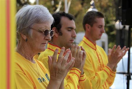 Falun Gong practitioners participate in a protest against China's crackdown on Falun Gong followers in front of the Chinese embassy in Bucharest September 24, 2011. REUTERS/Radu Sigheti