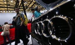 People look at Audi cars during the 15th Shanghai International Automobile Industry Exhibition in Shanghai April 21, 2013. REUTERS/Carlos Barria