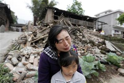 Rescuers struggle to reach China quake zone as toll...