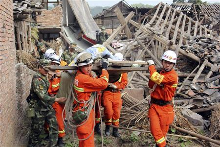 Rescuers carry out an elderly person from a collapsed house after a strong 6.6 magnitude earthquake hit Qingren township of Lushan county, Sichuan province April 20, 2013. REUTERS-Stringer