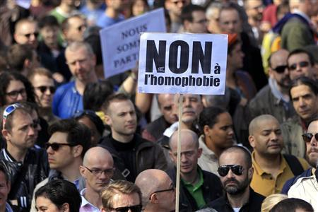 People gather at the Place de la Bastille from groups including Act-Up (AIDS Coalition to Unleash Power) to protest against homophobic attacks stemming from protests against France's planned legalisation of same-sex marriage in Paris, April 21, 2013. REUTERS-Gonzalo Fuentes (FRANCE - Tags: CIVIL UNREST POLITICS SOCIETY)