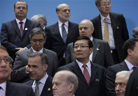 Chinese Minister of Finance Lou Jiwei (2nd R) joins finance ministers and central bank governors from the G20 for a family photo during 2013 Spring Meeting of the International Monetary Fund and World Bank in Washington, April 19, 2013. REUTERS/Yuri Gripas