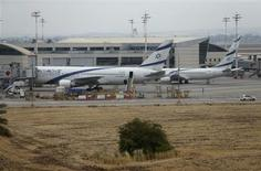 El Al planes are seen parked at Israel's Ben-Gurion International Airport near Tel Aviv, during a strike by airline workers, April 21, 2013. REUTERS/Nir Elias