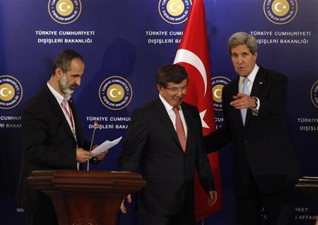 Turkish Foreign Minister Ahmet Davutoglu (C), U.S. Secretary of State John Kerry (R) and Syrian opposition leader Moaz al-Khatib leave a news conference after the Friends of Syria meeting in Istanbul April 20, 2013. REUTERS/Osman Orsal