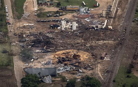 An aerial view shows the aftermath of a massive explosion at a fertilizer plant in the town of West, near Waco, Texas April 18, 2013. The death toll in the explosion at the plant has reached 14 people, Mayor Tommy Muska said on Thursday. REUTERS/Adrees Latif