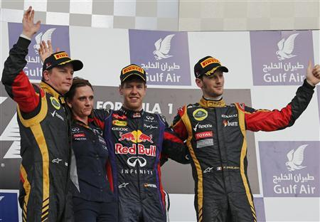 First placed Red Bull Formula One driver Sebastian Vettel of Germany (2nd R), second placed Lotus Formula One driver Kimi Raikkonen of Finland (L) and third placed Lotus Formula One driver Romain Grosjean of France (R) celebrate with Red Bull Formula One's Head of Trackside Electronics Gill Jones during the victory ceremony of the Bahrain F1 Grand Prix at the Sakhir circuit, south of Manama April 21, 2013. REUTERS/Ahmed Jadallah
