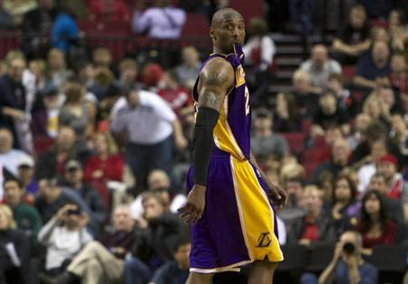 Los Angeles Lakers shooting guard Kobe Bryant (24) watches free throws at end of game against the Portland Trail Blazers during second half of their NBA basketball game in Portland, Oregon, April 10, 2013. REUTERS/Steve Dipaola