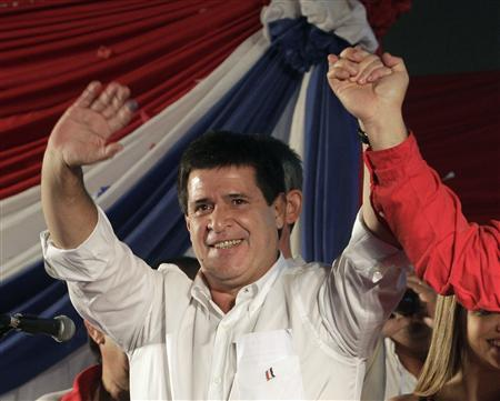 Paraguayan presidential candidate Horacio Cartes of the Colorado Party celebrates before speaking to supporters as he claims victory in the election in Asuncion, April 21, 2013. REUTERS/Mario Valdez
