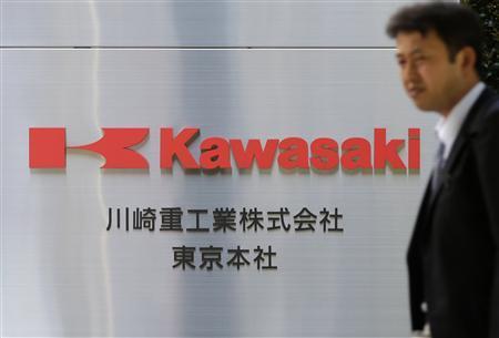 A man walks past a signboard of Kawasaki Heavy Industries, Ltd. at the company's Tokyo Head Office in Tokyo April 22, 2013. REUTERS/Toru Hanai