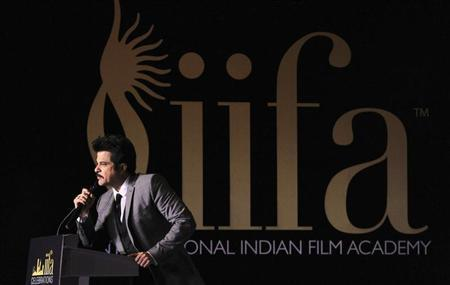 Bollywood actor Anil Kapoor speaks at a media event to announce the venue of the International Indian Film Academy (IIFA) Weekend and Awards, at a hotel in Singapore April 24, 2012. REUTERS/Tim Chong
