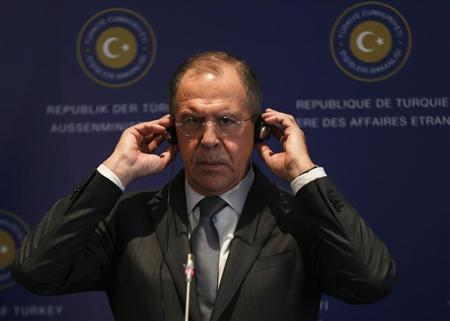 Russia's Foreign Minister Sergei Lavrov adjusts his earphones during a joint news conference with his Turkish counterpart Ahmet Davutoglu (not pictured) at Ciragan Palace in Istanbul April 17, 2013. REUTERS/Murad Sezer
