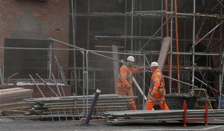 Workers carry scaffolding on a construction site in Chester, northern England March 20, 2013. REUTERS/Phil Noble