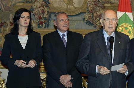 Italy's newly re-elected President Giorgio Napolitano (R) speaks next to Lower house president Laura Boldrini (L) and Upper house president Pietro Grasso at the Quirinale palace in Rome in this picture provided by the Italian Presidency Press Office April 20, 2013. REUTERS/Italian Presidency Press Office/Handout