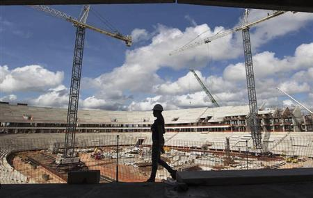 A worker walks inside the Arena da Amazonia, or Vivaldo Lima Stadium, as it is being rebuilt to host the 2014 World Cup, in Manaus April 12, 2013. REUTERS/Bruno Kelly