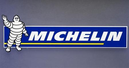 The logo of French tyremaker Michelin with Bibendum or the Michelin Man mascot is pictured during the company's 2011 annual results in Paris February 10, 2012. REUTERS/Charles Platiau