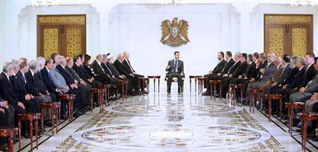Syria's President Bashar al-Assad (C) meets a Lebanese delegation representing national parties, forces and figures, in Damascus, in this handout photograph distributed by Syria's national news agency SANA on April 21, 2013. REUTERS/SANA/Handout