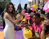 Reality TV star Khloe Kardashian signs autographs at the 2013 Kids Choice Awards in Los Angeles, California March 23, 2013. REUTERS/Phil McCarten